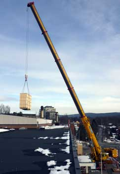 Lifting large components through the roof